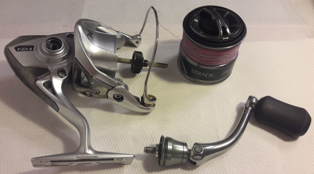 The three main parts of the Shimano Stradic FK. Spool, handle and the Hagane body.
